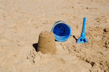 sandcastle: Sandcastle, bucket and spade on beach