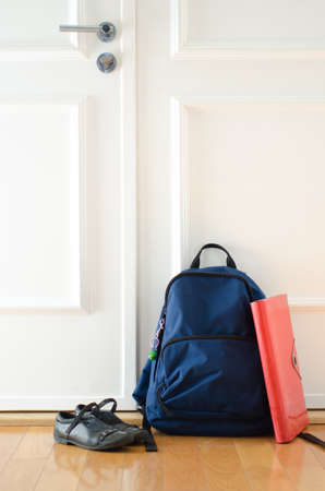 zapatos escolares: Back to school or ready for school concept with school bag and shoes by front door