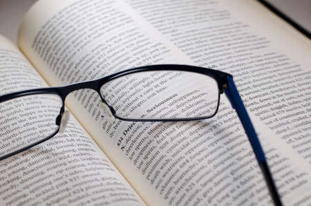 seriousness: Glasses on book highlighting the word seriousness
