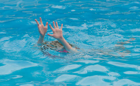 Child struggling and possibly drowning in a swimming pool