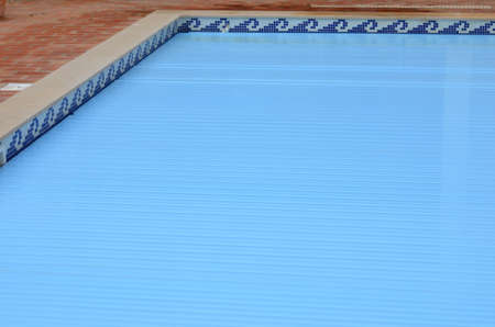 Electric slatted Swimming Pool cover on home swimming pool
