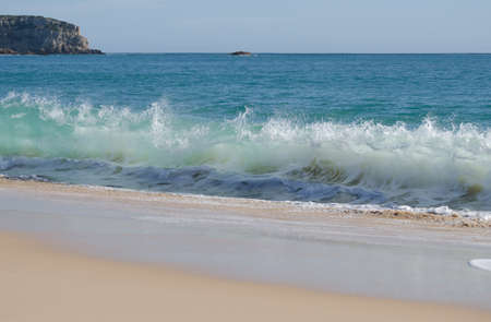 Waves breaking on the shore