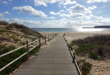 Empty wooden path to beach in winter