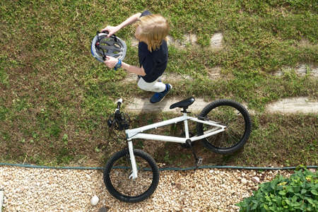 Child getting ready to go for a bike ride