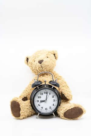 Time to go to bed concept with clock and teddy bear Foto de archivo