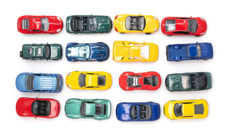Toy cars in neat rows of the four primary colours