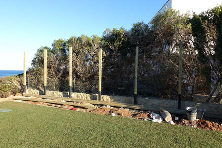 Installation of posts for preparation of new fence