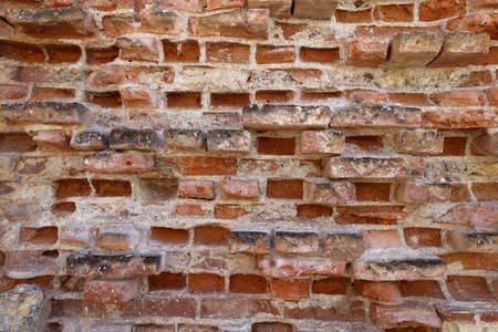 Very old and worn brick wall with red bricks Stockfoto
