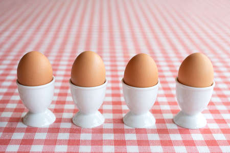Four boiled eggs in a row