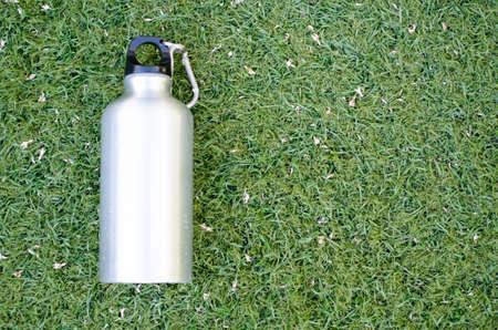 Reusable water bottle on a green grass background