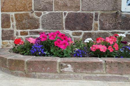 Flower bed with brick surround