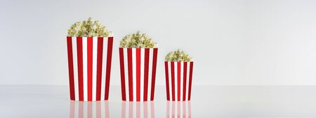 Popcorn box isolated on clean natural background. Good for watching cinema and movies. Delicious but unhealty nutrition.
