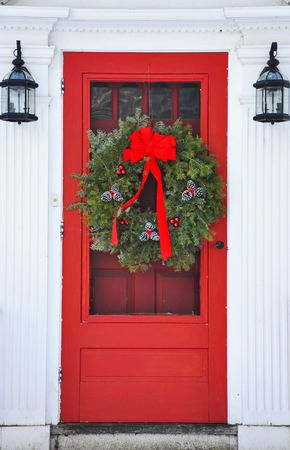 pine wreath: wreath on red front door