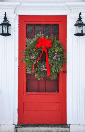 wreath on red front door