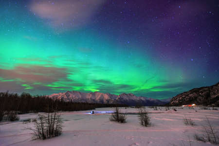 Beautiful green Northern light (Aurora Borealis) at Knik River in Alaska.  photo