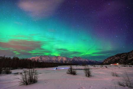 anchorage: Beautiful green Northern light (Aurora Borealis) at Knik River in Alaska.