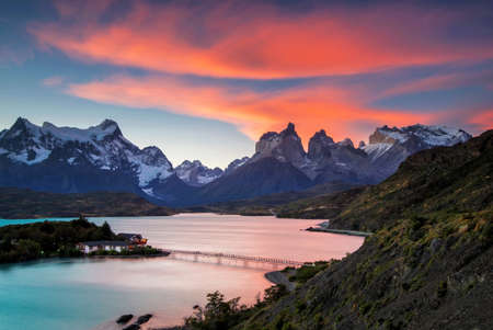 torres del paine: Beautiful sunset view at Lake Pehoe of the Torres Del Paine National Park. Special type of clouds (Lenticular clouds) created a wonderful red sky above the Chilean Patagonias mountain peaks
