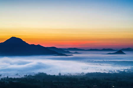 overlook: Phu Tok in the morning at sunrise is covered by sea of fog