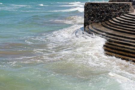 crashing: Waves crashing on the waterfront