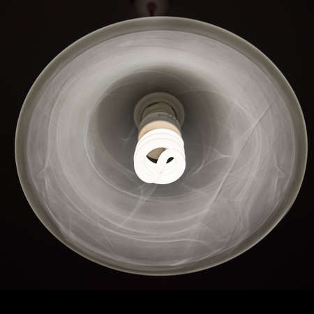 lamp shade: Cool daylight cfl bulb lamp with a lamp shade Stock Photo