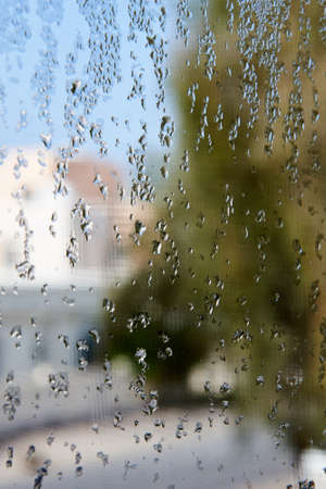pane: Condensation on a window pane with blurry background Stock Photo