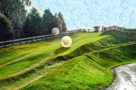 green fields: Rolling downhill in a zorb in New Zealand Stock Photo
