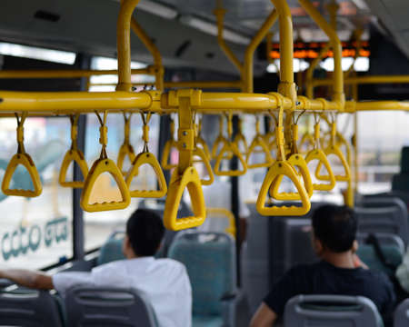 maintain: Straps to  hold to maintain balance in a commuter bus Stock Photo