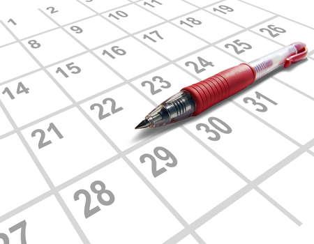 Red pen on a calendar Imagens