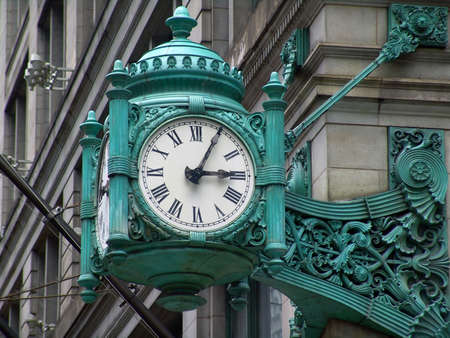 corner clock: Old stylish clock on a street corner                                Stock Photo