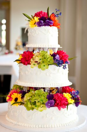 wedding cake with flowers on table photo