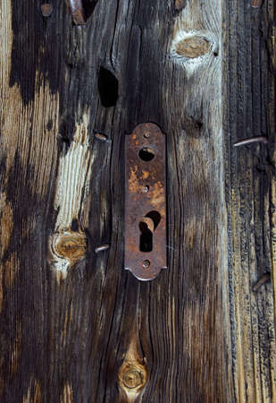 Vintage wooden door close up, with lock- keyhole