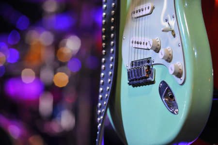 Guitar on stage for background, bokeh, colorful, soft focus and blur 版權商用圖片