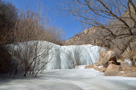 icefall: frozen waterfall in winter Stock Photo
