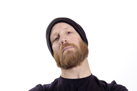 tough guy: serious tough guy with beard black hat isolated on white background Stock Photo