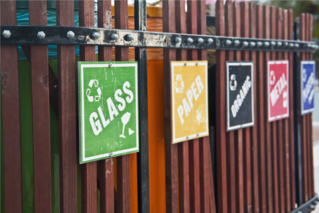 glass paper: recycle bin place with signs like glass, paper, metal