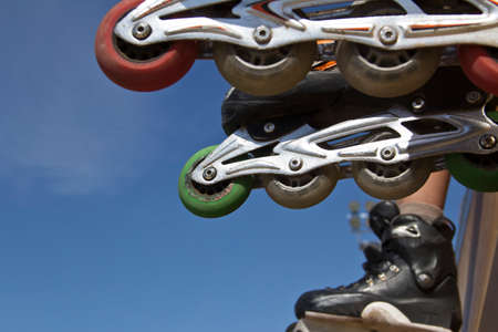 inline: inline skates close up in skate park Stock Photo