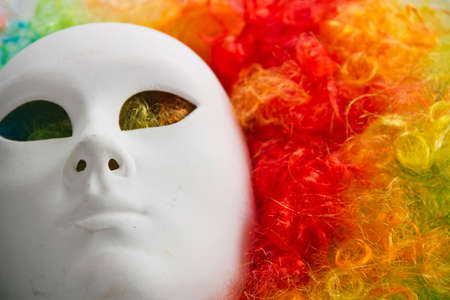 colorful rainbow wig and venice carnival mask photo