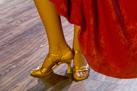 high  heeled: dancers legs with high heeled shoes on stage