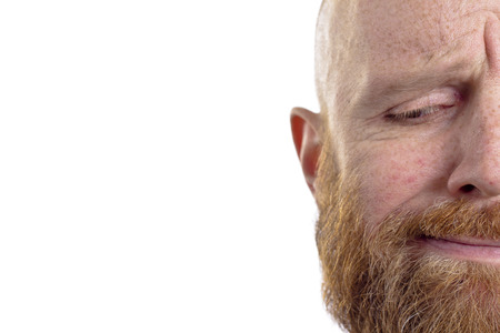 disapprove: bald man with red beard half face isolated on white background