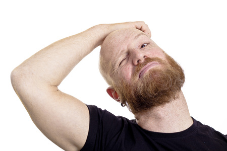 Bald man scratching his head isolated on white