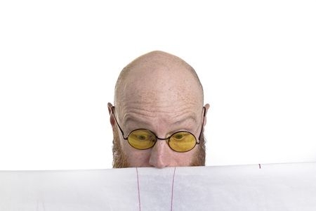 bald man looking surprised at his work isolated on white background photo