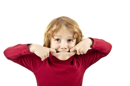 red hair child pulling face isolated on white background photo
