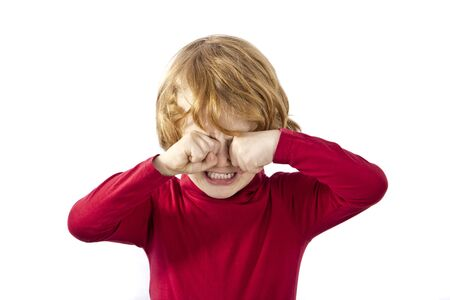 tired eyes: tired child rubbing his eyes isolated on white background