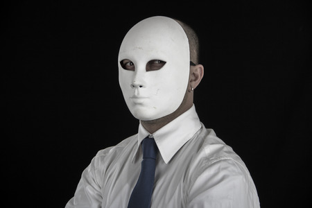 stranger: businessman in suit wearing mask, business power