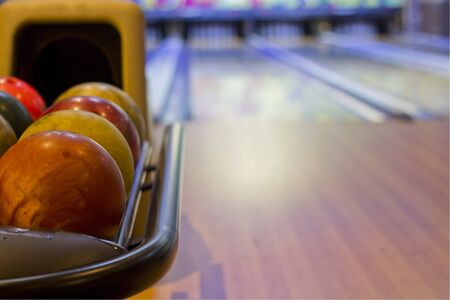 colorful bowling balls in front of tenpin alley Stock Photo