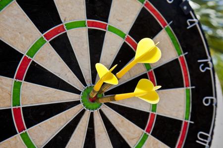 dart board with three darts in bullseye Stock Photo - 38937260