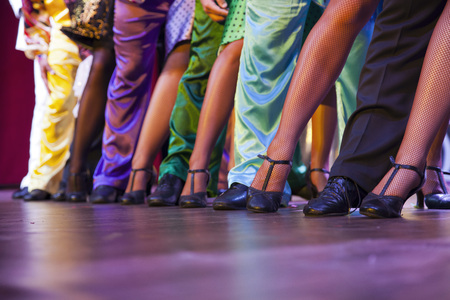 dancer legs: dancer legs performing on stage in colorful costumes