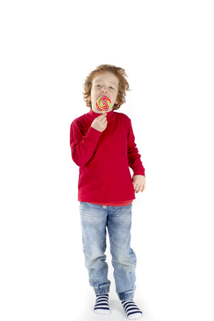 lolipop: Boy eating lolipop Stock Photo