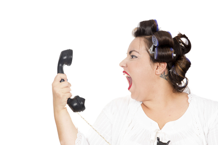 woman screaming at telephone Stock Photo