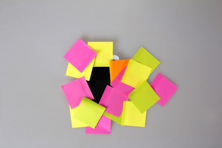 mobile phone covered in colorful blank post it notes Stock Photo